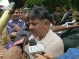 dk shivakumar seemed undeterred as the rebel leaders    supporters shouted slogans of go back and the