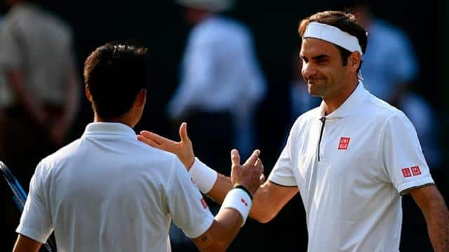tennis  federer in semifinals with 100th win in wimbledon