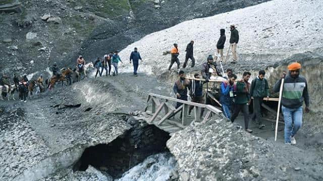 hindu pilgrims arrive to worship at the holy cave of lord shiva in amarnath