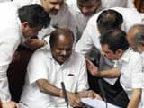 chief minister of karnataka hd kumaraswamy in conversation with other members during the trust motio