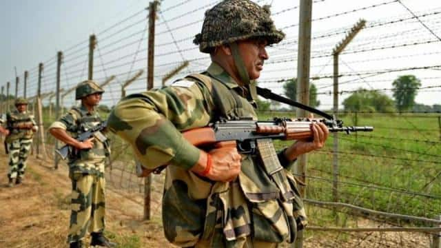 indian border security force  bsf  soldiers take up positions at an outpost along a fence at the ind