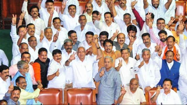 former chief minister of karnataka and bjp leader bs yeddyurappa shows victory sign along with other