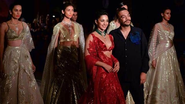 models present creations by designer amit aggarwal during the fdci india couture week 2019