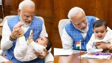 prime minister narendra modi shares photo with child on instagram