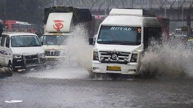 rain batters mumbai  flooded roads and rail tracks leave commuters stranded