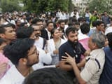 police scuffle with medical students as they protest against nmc bill outside safdarjung hospital