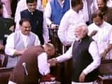 prime minister narendra modi greets union home minister amit shah after the jammu and kashmir reorga