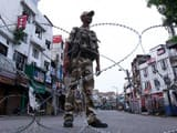 security personnel stand guard during restrictions in jammu