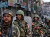 security forces personnel patrol a deserted street during restrictions in srinagar  reuters