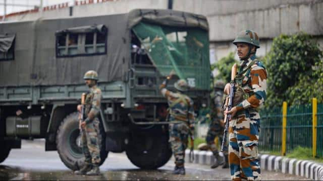 jammu  army personnel stand guard during restrictions  in jammu  monday  aug 05  2019 restrictions a