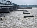 a view of the yamuna river as the water level rises after the water released from hathnikund barrage