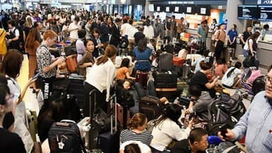 17 000 passengers stranded at tokyo airport due to typhoon faxai