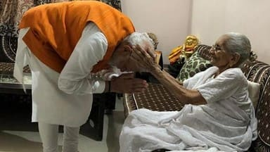 pm modi 69th birthday  pm modi meets mother over lunch seeks blessings