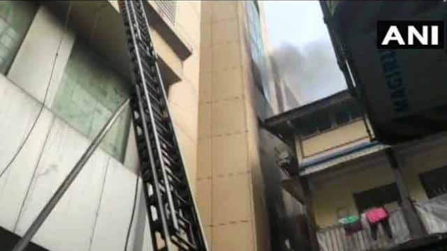 mumbai eight people stranded in the building have been rescued by the fire brigade