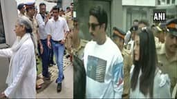 jaya bachchan  abhishek bachchan and aishwarya rai bachchan leave after casting their vote at a poll