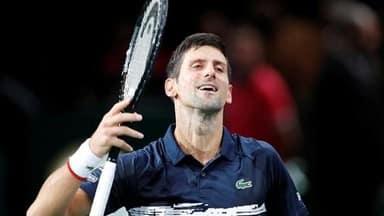 novak djokovic overcomes illness to advance in paris masters