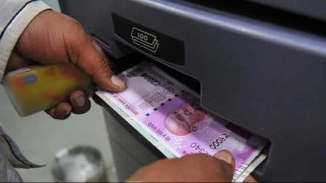 atm machine dispensing cash   shankar mourya ht photo