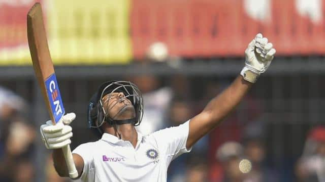 mayank agarwal holds up his bat as he reacts after scoring a century pti