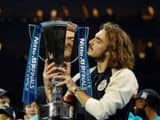 greece s stefanos tsitsipas celebrates winning the atp finals with the trophy  reuters