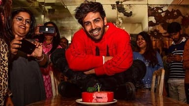 bollywood actor kartik aaryan cut a cake during his 29th birthday celebrations with media in mumbai