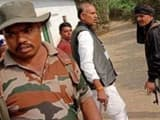 congress  daltonganj candidate kn tripathi seen with a pistol during voting for first phase of assem