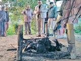 a woman burnt body found tied to cot in uttar pradesh bijnor