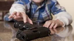 6 year old child fired his parents gun in school