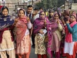 new delhi  women show their ink-marked fingers after casting votes for delhi assembly elections