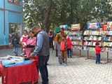 parents with children gathered in book fair of lakhimpur
