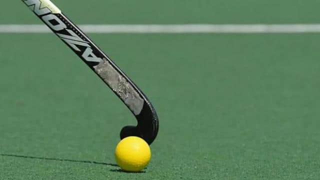 a field hockey stick hits the ball getty images