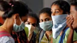 kerala coronavirus  a group of students wearing protective masks at kochi last month   reuters file