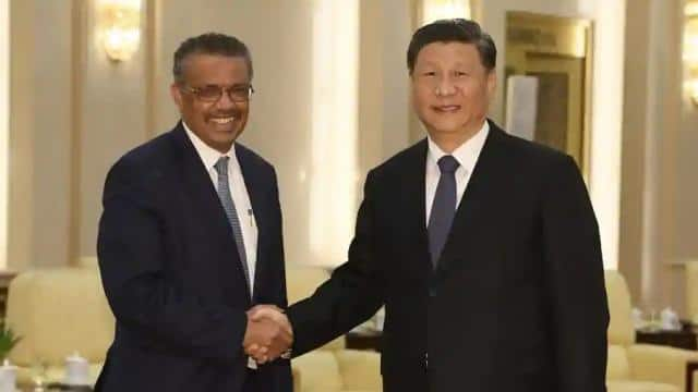 in this file photo  tedros adhanom  director general of the world health organization shakes hands w