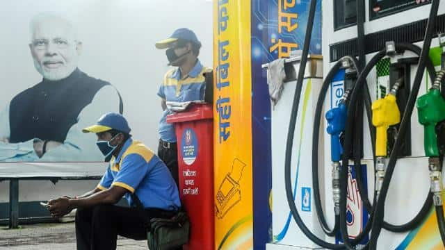ec orders removal of hoarding featuring prime minister photo from petrol pump premises