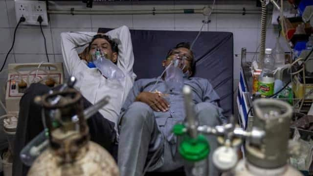 Patients suffering from the coronavirus disease (COVID-19) get treatment at the casualty ward in Lok Nayak Jai Prakash (LNJP) hospital, amidst the spread of the disease in New Delhi