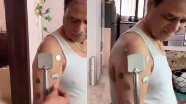 कोरोना वैक्सीन लेते ही शख्स बना 'मैग्नेट मैन'? शरीर से चिपकने लगी मेटल की चीजें, देखें वीडियो